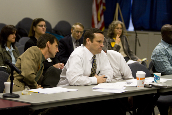 Dave Pringle (l) NJEF sits with and confers with fellow lobbyists from the Chamber of Commerce and Business & Industry Association