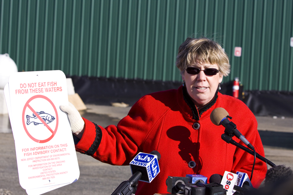 Judith Enck, EPA Region II REgional Administrator shows fish consumption advosry warning of PCB toxic contamination of fish in Bound Brook.