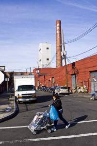 mother and child in industrial landscape of Paterson, NJ