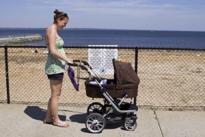 new mom strolls with infant past toxic lead beach. She knew nothing about the lead problems at the beach or in general.