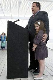 The Culmination: With his daughter Bridget at his side, Gov. Chris Christie announced at the Surfrider Beach Club in Sea Bright on Thursday that he is opposed to offshore drilling. (STAFF PHOTO: BRADLEY J. PENNER)