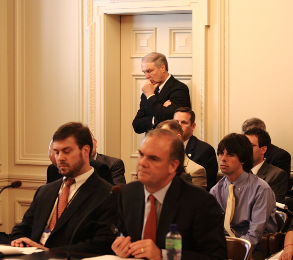 Jim Benton, read, head of NJ Petroleum Council, listens closely to DEP Commissioner Bob Martin speak on Gulf oil spill.