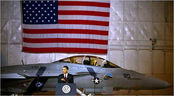 "Luke Sharrett/The New York Times - President Obama, with an F-18 ""Green Hornet"" that will run partly on bio fuel, during his speech on energy security on Wednesday at Andrews Air Force Base in Maryland."