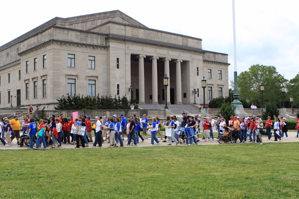 Protestors walk by War Memorial on way to State House rally against Christie education cuts (May 22, 2010)