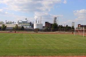 Paulsboro HS soccer field, in shaddow of Valero refinery. Prevailing winds blow pollution directly into the school.