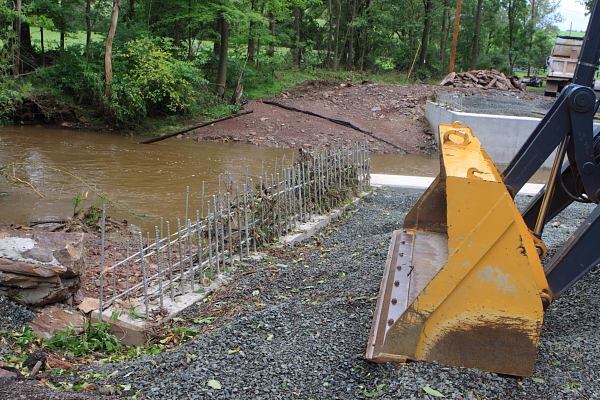 Alexauken Creek floodwater overtop new bridge abutments, adn almost wash away cosntruction equipment