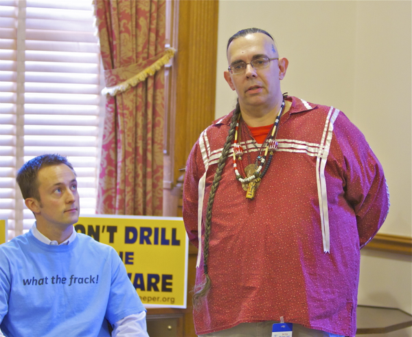 "Lenape Chief Chuck ""Gentle Moon"" DeMund (standing) and 350.org regional representative demand that Gov. Christie and President Obama ""Don't Drill the Delaware"" at Trenton State House news conference today"