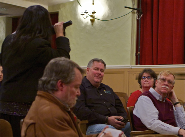 Lisa Riggiola (back turned on left, w/microphone) criticized Mayor Cole (R, in red)during comments at Dupont RCRA permit hearing on Acid Brook cleanup plan