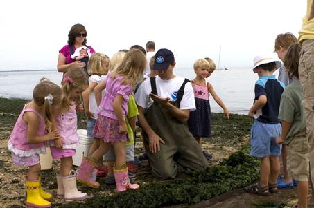NOAA scientist with kids at Sandy Hook