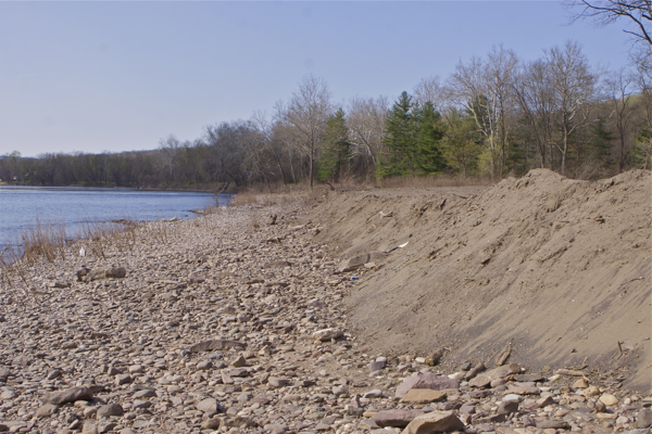 no erosion controls - heavy rain or rising river will wash this soil, fill, and debris right into the river