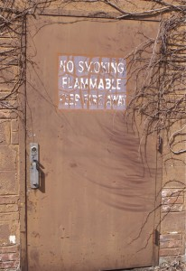 strong chemical odors emitted by this building - flammable warning sign invites arson or mischief
