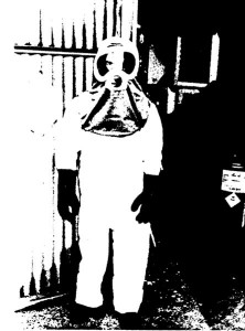 Troy Chemical worker wears respirator and protective gear to reduce mercury exposure - photo from NIOSH study of Troy plant