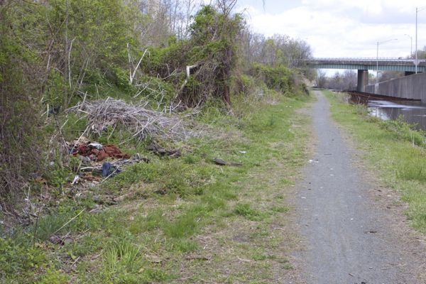 garbage dumped illegally just north of Perry Street trailhead