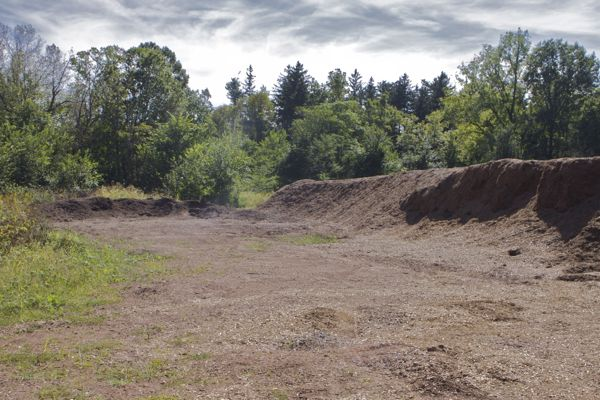 composting materials, no stormwater runoff controls - direct discharge to wetland
