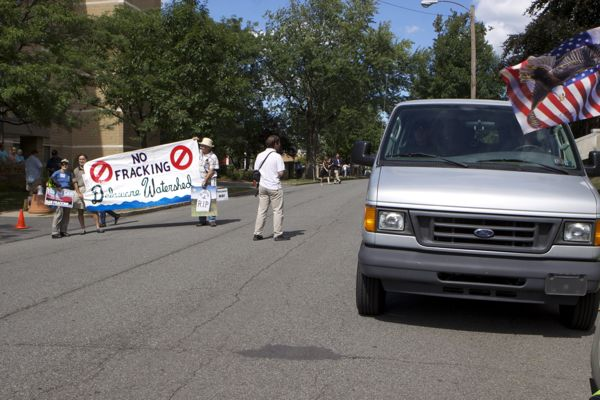 Who are those men in the van parked directly across the street from a fracking protest? See photo below