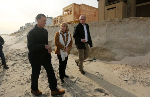 Lt. Governor Kim Guadagno walks with Rep Frank LoBiondo, left, and state DEP Commissioner Bob Martin past the eroded dunes of Long Beach Twp as she tours blizzard storm damage. 1/25/16 Long Beach Twp, NJ (John Munson | NJ Advance Media for NJ.com)