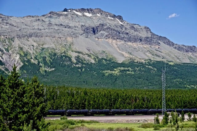 Bomb train at base of mountains that form boundary of Glacier National Park