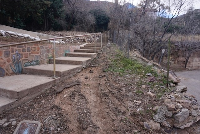 raw sewage eroded a gully along stairs