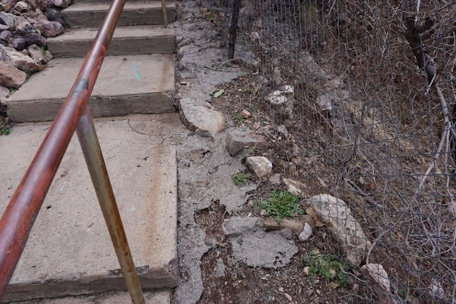 disgusting sewage sludge remains along stairs